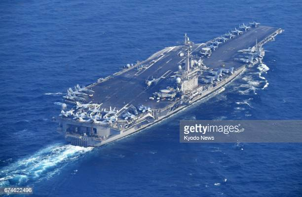 The aircraft carrier USS Carl Vinson is pictured about 60 kilometers south of Tsushima Island in Japan's Nagasaki Prefecture in this photo taken from...