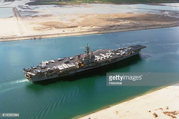 The aircraft carrier USS John F Kennedy transits the Suez Canal as it begins the journey to Naval Station Norfolk Virginia after taking part in...