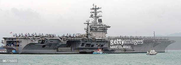 The aircraft carrier USS Nimitz is berthed at the mouth of Victoria Harbour during the ship's visit to Hong Kong on February 17 2010 The Nimitz...