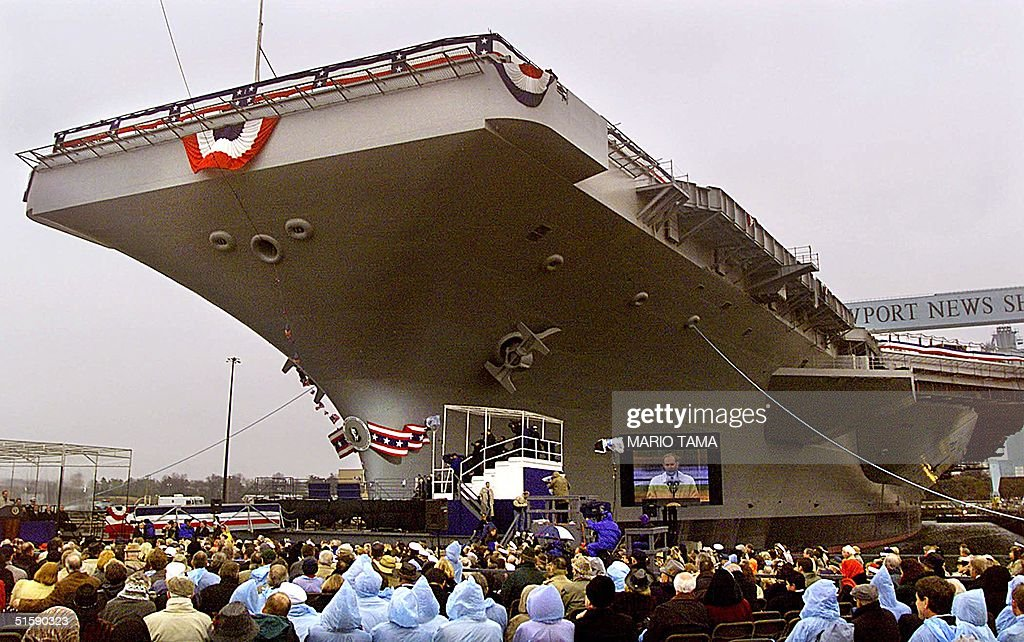 The aircraft carrier USS Ronald Reagan looms above the crowd attending the christening ceremony for the ship 04 March at Newport News Shipbuilding...