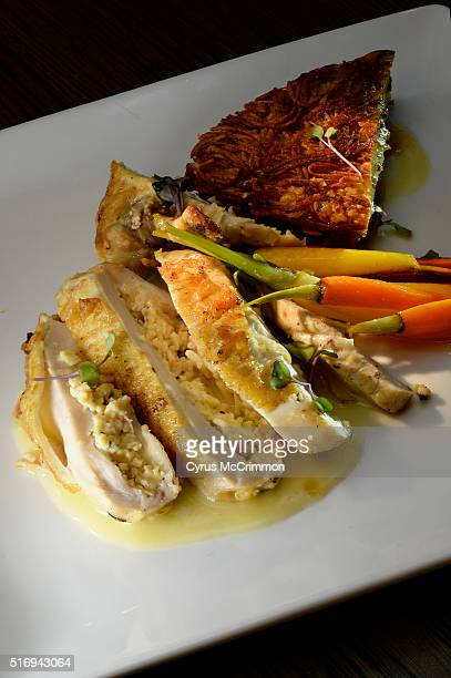 The airline chicken with glazed baby carrots and a potato rösti at the new restaurant Bacon Social House in NW Denver on Thursday March 17 2016