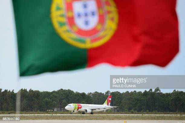 The airplane carrying Pope Francis taxies on the tarmac upon his departure from Portugal on its way to Rome at Monte Real air base in Leiria on May...