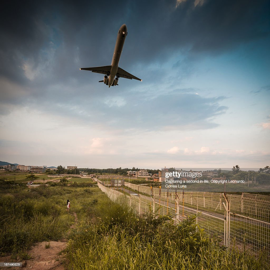 The airplane on final approach, China : Stock Photo