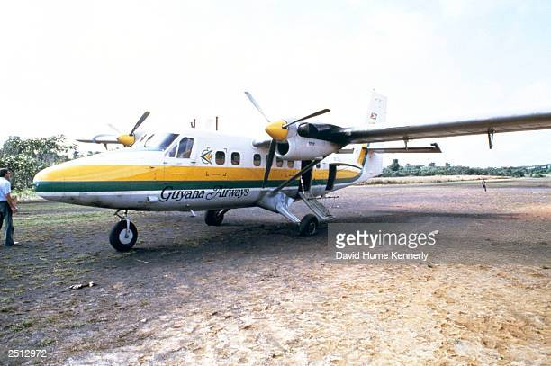 The airplane which carried California Congressman Leo Ryan sits on a runway November 18 1978 in Port Kaituma Guyana after he was shot and killed by...