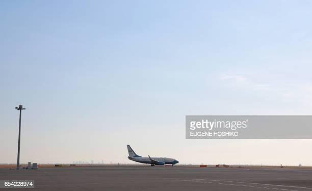 The airplane with US Secretary of State Rex Tillerson aboard prepares for departure at Haneda International Airport in Tokyo on March 17 2017 / AFP...