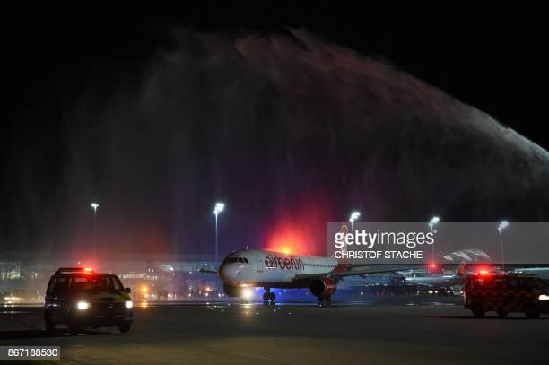 The airport fire department spays water over the airbus of German airline Air Berlin the last scheduled flight before take off at FranzJosefStrauss...