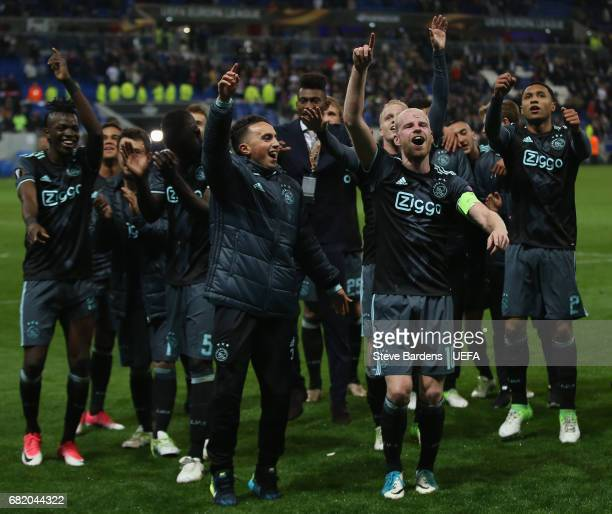 The Ajax Amsterdam players celebrate their victory over Olympique Lyonnais after the Uefa Europa League semi final second leg match between Olympique...
