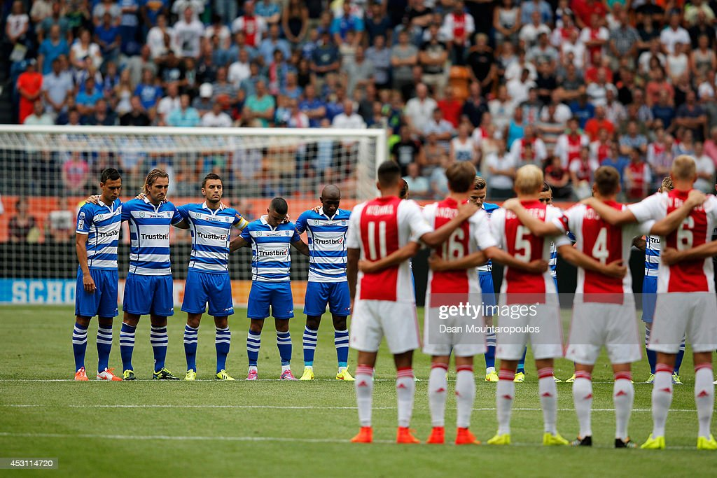 The Ajax and Zwolle players stand for one minute's silence in tribute to the victims of the MH17 flight prior to the 19th Johan Cruijff Shield match...