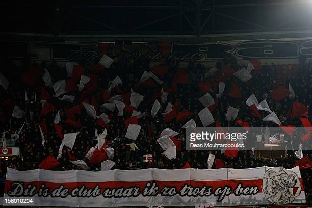 The Ajax fans cheer during the Eredivisie match between Ajax Amsterdam and FC Groningen at Amsterdam Arena on December 8 2012 in Amsterdam Netherlands