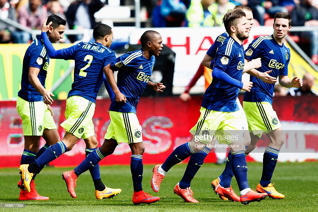 The Ajax players celebrate after Ramon Leeuwin (not in frame) of Utrecht scores an own goal during the Dutch Eredivisie match between FC Utrecht and Ajax Amsterdam held at Stadion Galgenwaard on April 5, 2015 in Utrecht, Netherlands.