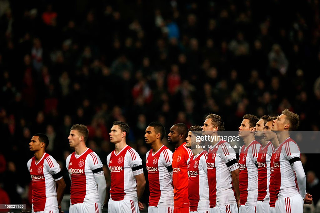 The Ajax players stand for the minute silence prior to the Eredivisie match between Ajax Amsterdam and FC Groningen at Amsterdam Arena on December 8, 2012 in Amsterdam, Netherlands. The minute silence was for Richard Nieuwenhuizen, 41, who was attacked while officiating for the Buitenboys team in an under-17 match in Almere last Sunday. He died the following day.