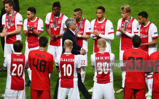 The Ajax team create a guard of honor for Jose Mourinho Manager of Manchester United after the UEFA Europa League Final between Ajax and Manchester...