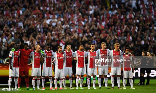 The Ajax team take part in a minutes silence in memory of the victims of the Manchester Concert attack prior to the UEFA Europa League Final between...