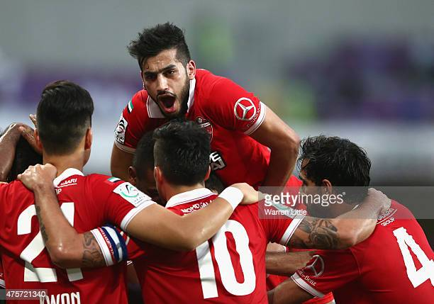The Al Ahli team celebrate the opening goal of Ahmed Khalil Sebait Mubark Alkunaibi during the President's Cup Final between Al Ahli and Al Nasr at...