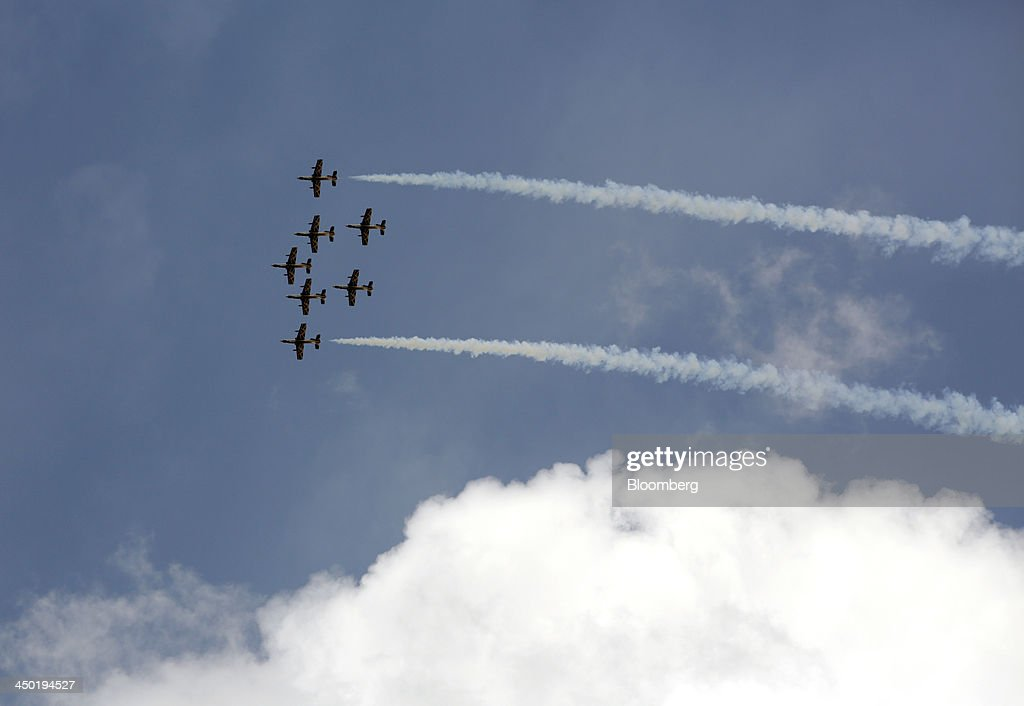 The Al Fursan aerobatic squad, flying aircraft manufactured by Alenia Aermacchi SpA., are seen during their air display at the 13th Dubai Airshow at Dubai World Central (DWC) in Dubai, United Arab Emirates, on Sunday, Nov. 17, 2013. The 13th edition of the biennial 2013 Dubai Airshow, the Middle East's leading aerospace event organized by F&E Aerospace. Photographer: Jason Alden/Bloomberg via Getty Images