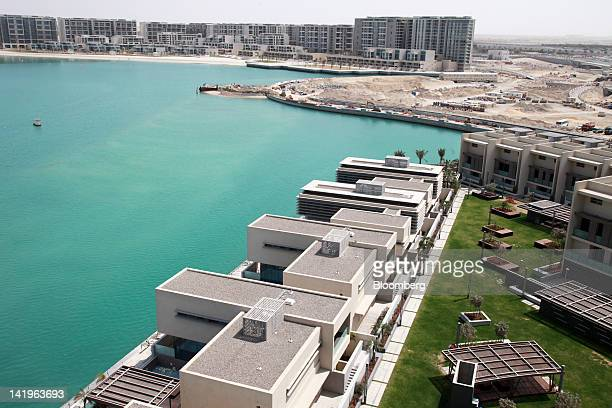 The Al Muneera bottom and Al Zeina top property developments are seen during a media tour organized by Aldar Properties PJSC Abu Dhabi's biggest real...