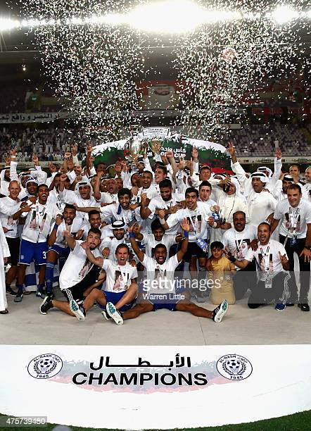 The Al Nasr team celebrate winning the President's Cup Final after a penalty shoot out between Al Ahli and Al Nasr at Hazza bin Zayed Stadium on June...
