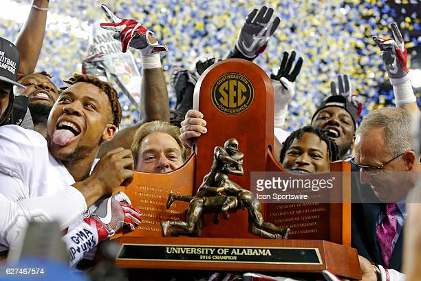 The Alabama Crimson Tide celebrate their victory with the SEC trophy at the conclusion of the SEC Championship football game against the Florida...