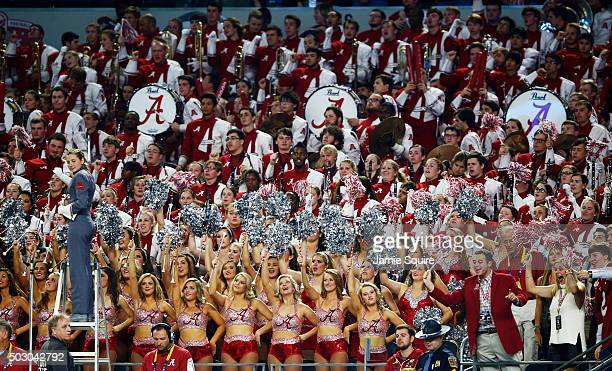 The Alabama Crimson Tide cheerleaders and fans are seen in the fourth quarter during the Goodyear Cotton Bowl at ATT Stadium on December 31 2015 in...