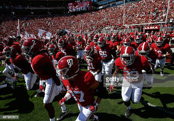 The Alabama Crimson Tide enter the field to face the Middle Tennessee Blue Raiders at BryantDenny Stadium on September 12 2015 in Tuscaloosa Alabama