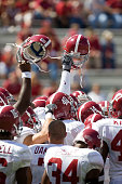 The Alabama Crimson Tide huddle together before a game against the Arkansas Razorbacks at Donald W Reynolds Stadium on September 23 2006 in...