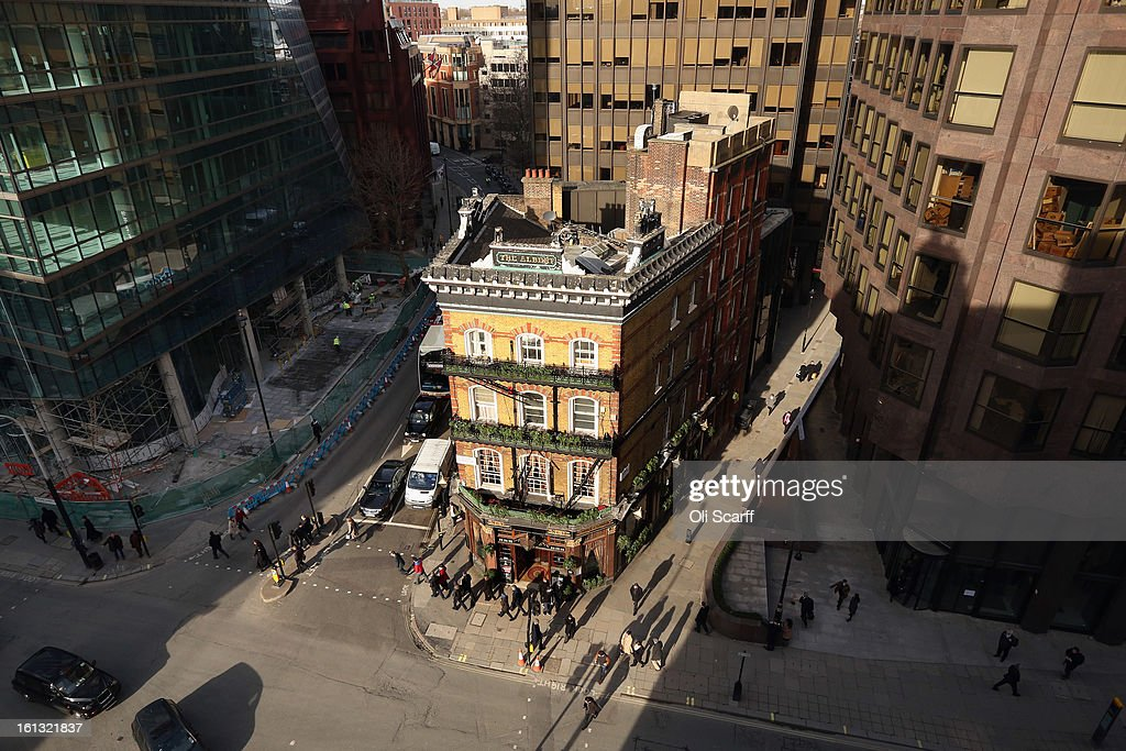 The Albert Tavern, a Victorian public house built in 1864 stands next to the modern office redevelopment of Selborne House (L) on Victoria Street on February 7, 2013 in London, England. The pub, which stands a short distance from Parliament, was named in honour of Queen Victoria's husband, the Prince Consort and has survived the extensive redevelopment of many of its neighbours.