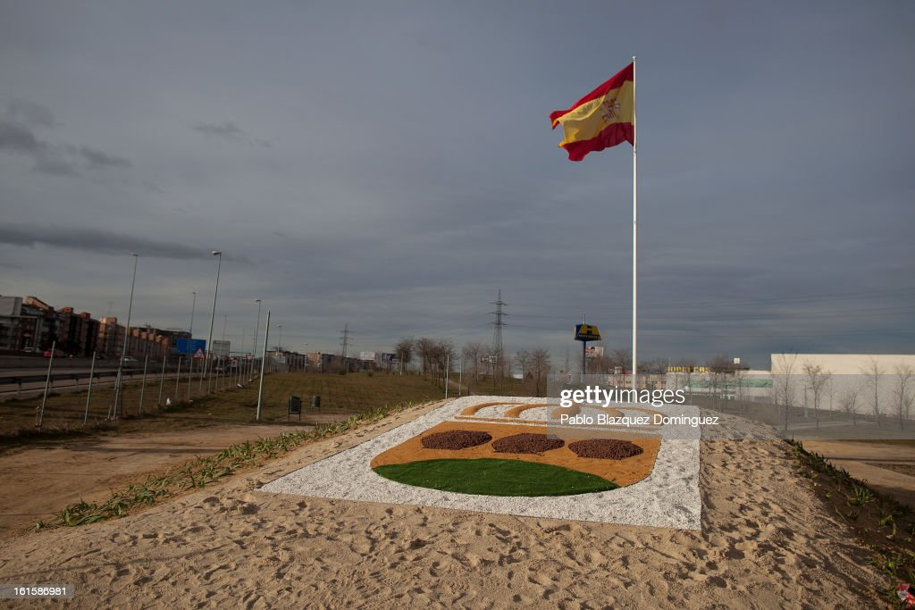 The Alcorcon emblem and Spanish flag stand on the site of the proposed 'Eurovegas' complex on February 10, 2013 in Alcorcon, near Madrid, Spain. Controversial plans have been given the go ahead for the Las Vegas Sands Corporation to build Europe's biggest casino and conference centre on the outskirts of Madrid bringing thousands of much needed jobs for the Spanish economy. As multi billionaire investor Sheldon Adelson's announced his plans protestors were claiming that the 36,000 room hotel complex would bring gambling addiction, criminal activity, prostitution and environmental damage to the area.