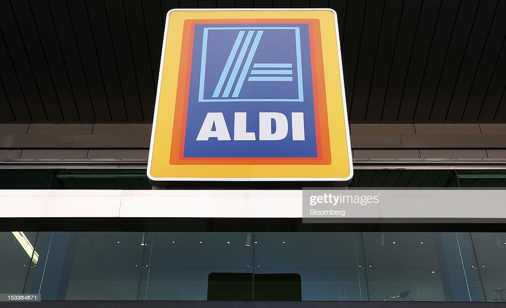 The Aldi logo sits above the entrance of a supermarket operated by Aldi Group, Germany's biggest discount-food retailer, in this arranged photograph in Manchester, U.K., on Thursday, Oct. 4, 2012. U.K. shop-price inflation slowed in September as retailers offered discounts to attract cash-strapped consumers, the British Retail Consortium said. Photographer: Paul Thomas/Bloomberg via Getty Images