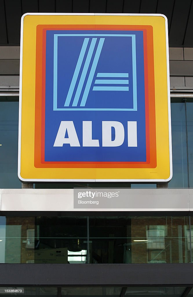 The Aldi logo sits outside a supermarket operated by Aldi Group, Germany's biggest discount-food retailer, in this arranged photograph in Manchester, U.K., on Thursday, Oct. 4, 2012. U.K. shop-price inflation slowed in September as retailers offered discounts to attract cash-strapped consumers, the British Retail Consortium said. Photographer: Paul Thomas/Bloomberg via Getty Images