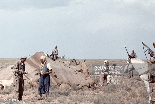The Algerian War identity control in Algeria in 1959 Algerian auxiliaries of french army controles papers of nomad shepherd and his family installed...