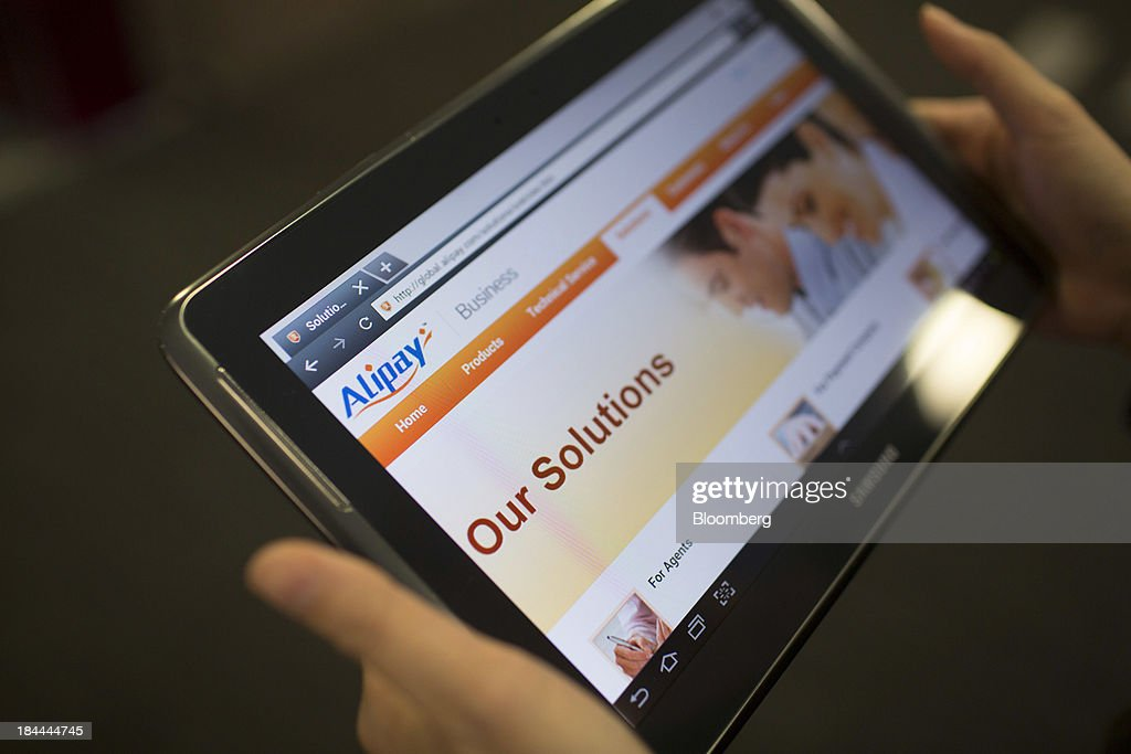 The Alibaba Group Holding Ltd. Alipay.com Co. website, displayed on a Samsung Electronics Co. tablet, is seen in an arranged photograph in Hong Kong, China, on Friday, Oct. 11, 2013. Alibaba, Chinas largest e-commerce company, will go public in 2014 after talks with Hong Kongs exchange on a proposed corporate governance structure fell apart, said people with knowledge of the matter. Photographer: Brent Lewin/Bloomberg via Getty Images