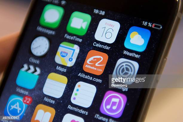 The Alibaba Group Holding Ltd app icon sits displayed on an Apple Inc iPhone smart device screen in this arranged photograph in Hong Kong China on...