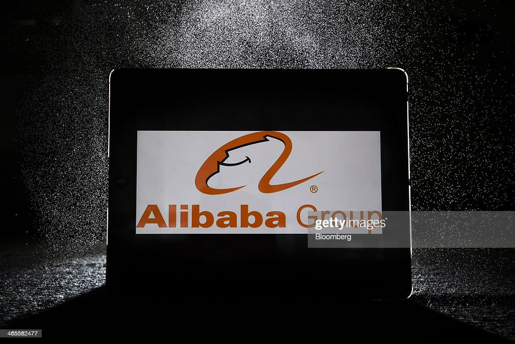 The Alibaba Group Holding Ltd. logo is displayed on an Apple Inc. iPad in an arranged photograph in Hong Kong, China, on Tuesday, Jan. 28, 2014. Alibaba, China's largest e-commerce company, said in November that it's deciding whether to sell shares in the U.S. or Hong Kong. Photographer: Brent Lewin/Bloomberg via Getty Images