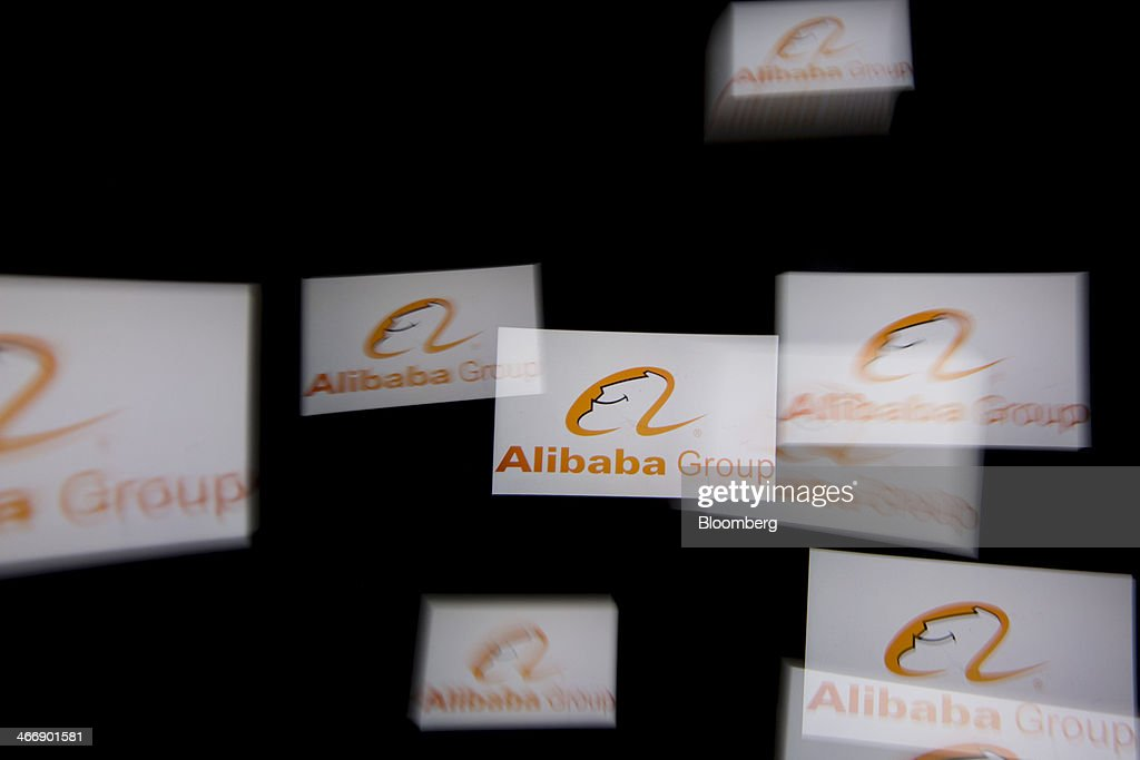 The Alibaba Group Holding Ltd. logo is flashed multiple times in the viewfinder of a digital camera in this arranged long exposure photograph in Hong Kong, China, on Tuesday, Jan. 28, 2014. Alibaba, China's largest e-commerce company, said in November that it's deciding whether to sell shares in the U.S. or Hong Kong. Photographer: Brent Lewin/Bloomberg via Getty Images