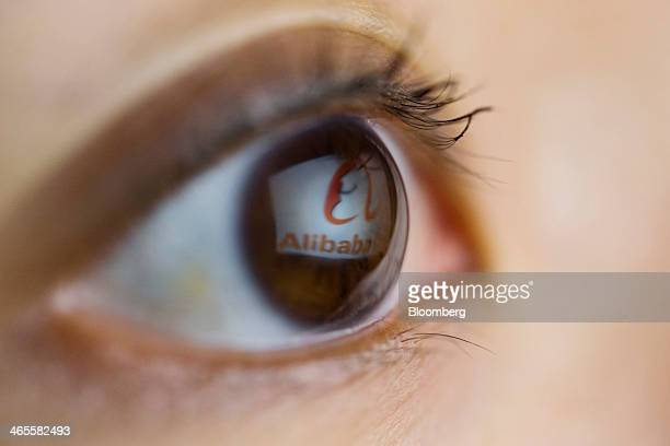 The Alibaba Group Holding Ltd logo is reflected on the eye of a woman in an arranged photograph in Hong Kong China on Tuesday Jan 28 2014 Alibaba...