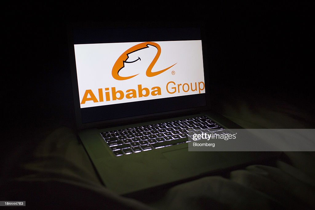 The Alibaba Group Holding Ltd. logo is seen on a laptop screen in an arranged photograph in Hong Kong, China, on Friday, Oct. 11, 2013. Alibaba, Chinas largest e-commerce company, will go public in 2014 after talks with Hong Kongs exchange on a proposed corporate governance structure fell apart, said people with knowledge of the matter. Photographer: Brent Lewin/Bloomberg via Getty Images