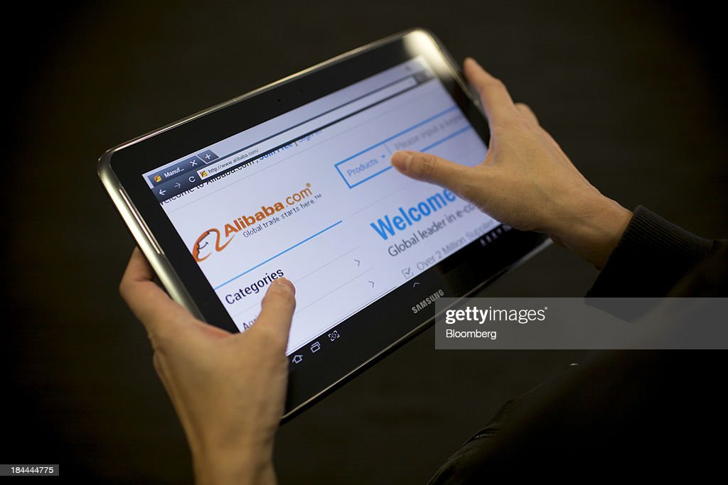 The Alibaba Group Holding Ltd. website, displayed on a Samsung Electronics Co. tablet, is seen in an arranged photograph in Hong Kong, China, on Friday, Oct. 11, 2013. Alibaba, Chinas largest e-commerce company, will go public in 2014 after talks with Hong Kongs exchange on a proposed corporate governance structure fell apart, said people with knowledge of the matter. Photographer: Brent Lewin/Bloomberg via Getty Images