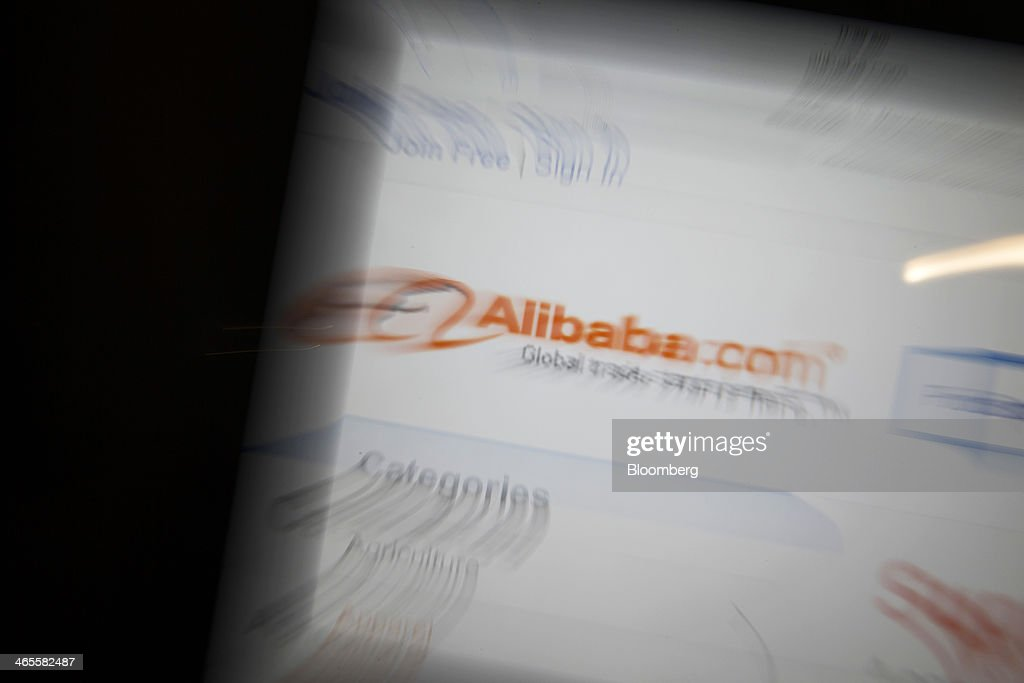 The Alibaba Group Holding Ltd. website is displayed on an Apple Inc. iPad in an arranged photograph in Hong Kong, China, on Tuesday, Jan. 28, 2014. Alibaba, China's largest e-commerce company, said in November that it's deciding whether to sell shares in the U.S. or Hong Kong. Photographer: Brent Lewin/Bloomberg via Getty Images