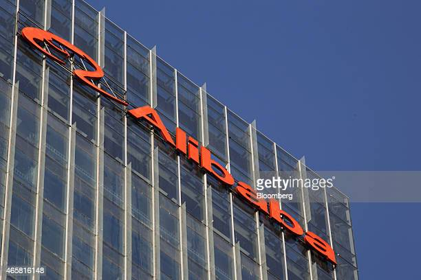 The Alibaba Group Holdings Ltd logo sits atop the company's headquarters standing near completion at the Greenland Centre developed by Greenland...