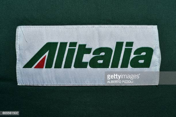 The Alitalia air carrier logo is pictured on a worker's jacket during a protest rally on March 20 2017 at Rome's Fiumicino airport Air traffic in...