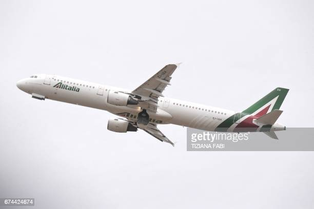 The Alitalia plane transporting Pope Francis for a twodays visit in Egypt takesoff on April 28 2017 at Rome's Fiumicino airport / AFP PHOTO / Tiziana...
