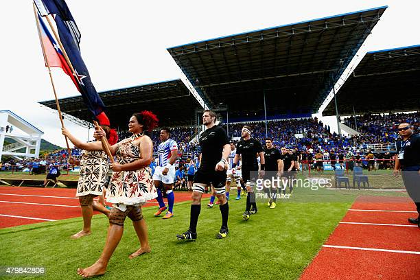 The All Blacks and Manu Samoa walk out onto the field before the International Test match between Samoa and the New Zealand All Blacks at Apia...