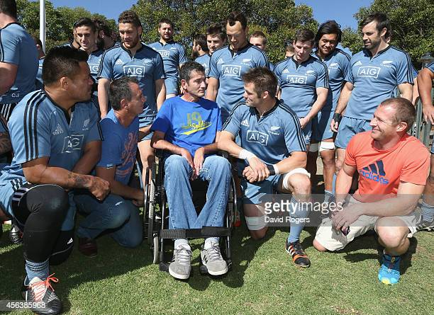 The All Blacks captain Richie McCaw talks to former Springbok Joost van der Westhuizen who now suffers with motor neurone disease after the All...