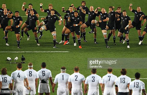 The All Blacks perform the haka as the French team advance towards them during the 2011 IRB Rugby World Cup Final match between France and New...