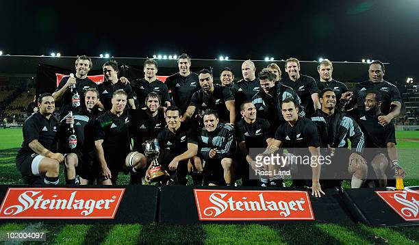 The All Blacks pose for a team photo with the Steinlager Series Cup following the International rugby test match between the New Zealand All Blacks...