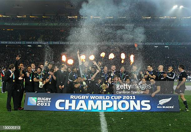 The All Blacks pose with the Webb Ellis Trophy after winning the 2011 IRB Rugby World Cup Final match between France and New Zealand at Eden Park on...