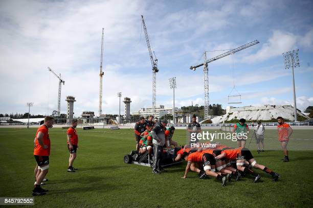 The All Blacks practice the scrum during a New Zealand All Blacks training session at Alexandra Park on September 12 2017 in Auckland New Zealand
