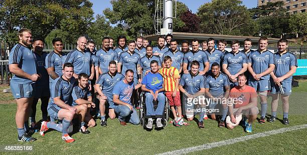 The All Blacks squad pose with former Springbok Joost van der Westhuizen who now suffers with motor neurone disease after the All Blacks training...