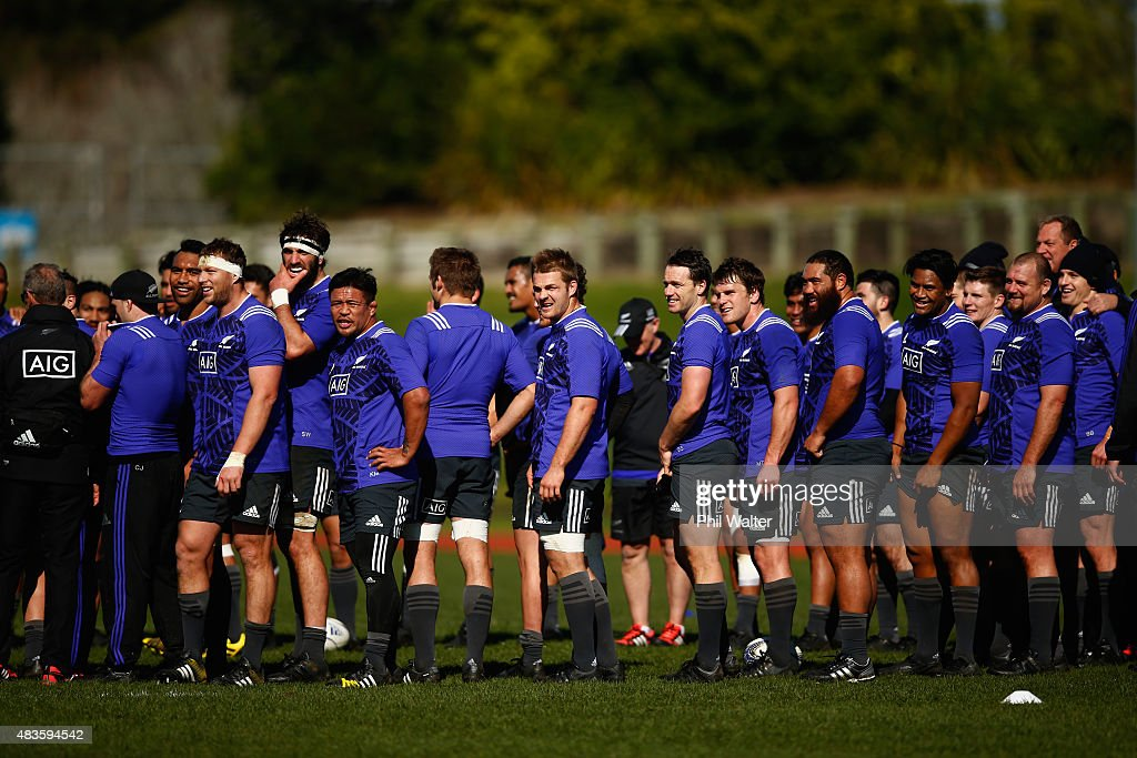 The All Blacks wait for players to join the team huddle during a New Zealand All Blacks training session at Trusts Stadium on August 11, 2015 in Auckland, New Zealand.