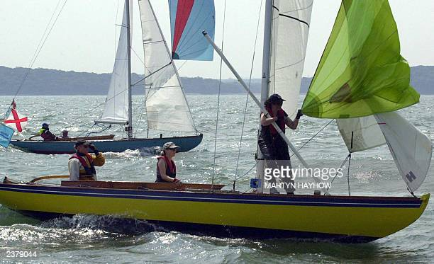 The all female helm and crew of 'Little Lady' in the Solent Sunbeam fleet prepare to hoist their spinnaker at the windward mark during day three's...